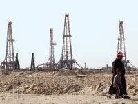 שדה נפט בבצרה, עיראק / צילום: רויטרס