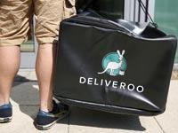 שליח של Deliveroo בלונדון / צילום: רויטרס, Neil Hall