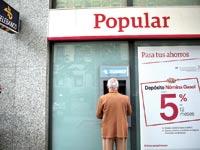 סניף בנק פופולר בספרד / צילום: רויטרס