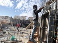 פועל בניין / צילום: בלומברג