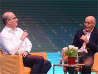 מימין: שוקי גלייטמן ויורם טיץ בכנס Journey / צילום: איל יצהר