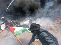 ההפגנות ליד הגדר. חמאס שילם 50 דולר למשפחה, 20 דולר ליחיד / צילום: רויטרס, Ibraheem Abu Mustafa