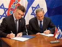 בנימין נתניהו ואנדריי פלנקוביץ' בטקס חתימת הסכם בילטרלי בירושלים / צילום: רויטרס