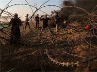 עימותים על הגדר ברצועת עזה / צילום: רויטרס