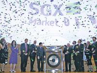 יום מסחר בבורסה הסינגפורית / צילום: Edgar Su, רויטרס