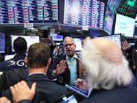 סוחרים בבורסת ניו יורק/צילום: רויטרס - Brendan McDermid