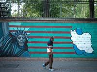 "גרפיטי נגד ארה""ב ברחוב בטהראן,/ צילום: רויטרס"