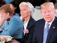 מנהלת קרן המטבע כריסטין לגארד והנשיא טראמפ / צילום: רויטרס, Yves Herman
