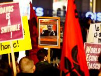 מפגינים נגד טראמפ בדאבוס / צילום: רויטרס, Pierre Albouy