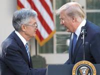 טראמפ ופאוול / צילום: רויטרס, Carlos Barria