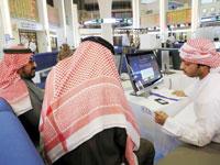 משקיעים בשוק הפיננסי בדובאי / צילום: רויטרס
