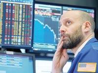 סוחר מודאג בוול סטריט / צילום: Brendan McDemid, רויטרס