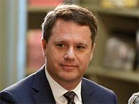 """דאג מקמילן, מנכ""""ל וולמארט / צילום: רויטרס"""