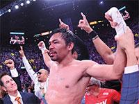 """עמנואל """"מאני"""" פאקיו. מתאגרף, פוליטיקאי ושחקן / צילום: Joe Camporeale, רויטרס"""