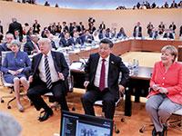 """מרקל, שי ג'יאנפינג וטראמפ. גרמניה מצאה את עצמה בין ארה""""ב לסין  / צילום: רויטרס"""
