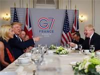 דונלד טראמפ ובוריס ג'ונסון מתבדחים בפסגת G7 / צילום: דילן מרטינז, רויטרס