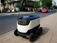 רובוט שליחויות של חברת סטארשיפ / צילום: Wolfgang Rattay, רויטרס