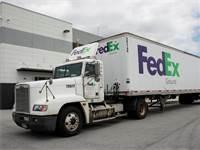 משאית של FedEx / צילום: Kamil Krzaczynski, רויטרס