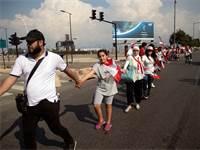 השרשרת האנושית בלבנון / צילום: Alkis Konstantinidis, רויטרס