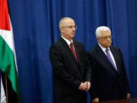 """יו""""ר הרשות אבו מאזן וראש הממשלה הפלסטינית ראמי חמדאללה/  צילום: רויטרס: Mohamad Torokman"""