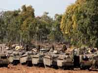 """חיילי צה""""ל על גבול רצועת עזה,/ צילום: רויטרס"""