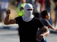 יידוי אבנים בגדה המערבית / צילום: Majdi Mohammed, AP