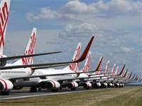 מטוסים של וירג'ין אוסטרליה חונים בנמל התעופה / צילום: Darren England/AAP Image, AP