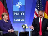"""טראמפ ומרקל בפגישתם בוועידת נאט""""ו בלונדון / צילום: KEVIN LAMARQUE, רויטרס"""