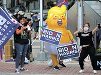 תומכי ג'ו ביידן במיאמי, פלורידה / צילום: MARCO BELLO, רויטרס