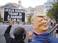 הפגנה נגד הנשיא דונלד טראמפ, מחוץ לבית הלבן, השבוע  / צילום: Yegor Aleyev, רויטרס