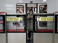 הרכבת התחתית בביג'ינג  / צילום: Aly Song, רויטרס
