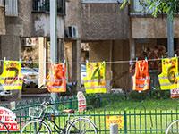 מיצג לזכר עובדי בניין שנהרג / צילום: שלומי יוסף