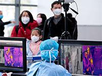 בדיקת נוסעים בעת הצ'ק אין בנמל תעופה בסין / צילום: רויטרס