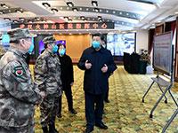 נשיא סין שי מקבל תדרוך על בית החולים Huoshenshan שבמחוז חוביי, מוקד התפרצות הקורונה / צילום: Xie Huanchi/Xinhua, Associated Press