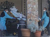 פינוי חולה קורונה במדינת וושינגטון / צילום: Ted S. Warren, Associated Press