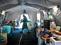 מתקן חירום לטיפול בחולי קורונה באיטליה / צילום: Claudio Furlan, Associated Press
