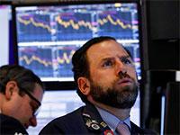 סוחר בבורסת וול סטריט על רקע הירידות / צילום: Associated Press