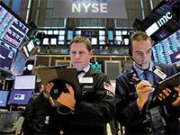 בורסת NYSE. עולם עמוס בחובות יהיה עסוק יותר בחובות מאשר בצמיחה  / צילום:  Andrew Kelly, רויטרס