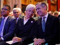 הנגיד הבריטי קרני (מימין) שפורש היום, ונשיאת  ה־ECB לגארד / צילום: רויטרס