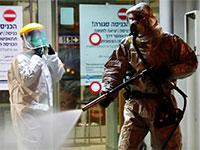 חיטוי נגד קורונה בישראל / צילום: Ariel Schalit, Associated Press