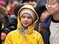 גרטה תונברג מובילה הפגנת צעירים למען האקלים בבריסטול / צילום: Peter Nicholls, רויטרס