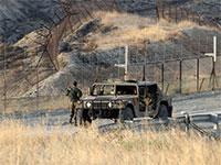 חיילים על גבול ירדן בבקעה  / צילום: Ammar Awad, רויטרס