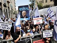 """תומכי נתניהו מחוץ לביהמ""""ש: """"העם דורש צדק משפטי"""" / צילום: Sebastian Scheiner, Associated Press"""