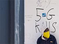 גרפיטי נגד טכנולוגיית הדור החמישי, בלונדון / צילום: רויטרס