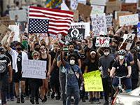 מתוך ההפגנה בדטרויט, מישיגן / צילום: Paul Sancya, Associated Press