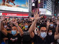 תושבי הונג קונג מפגינים נגד חוק הביטחון הלאומי, החודש / צילום: Vincent Yu, Associated Press