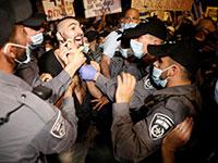 מתוך ההפגנה מול בלפור אמש / צילום: Ariel Schalit, Associated Press
