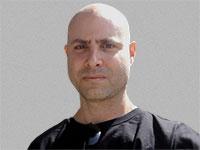 גיא פריזמנט, בעלים של חברת GuyVision שעוסקת בהקרנות וידאו / צילום: תמונה פרטית