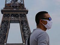 פריז. הממשלה במדינה כי החל מיום שני הקרוב תוטל חובת לבישת מסכה גם באוויר הפתוח / צילום: Michel Euler, Associated Press