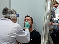 בדיקות קורונה בשדה התעופה של פרנקפורט, גרמניה / צילום: Michael Probst, Associated Press